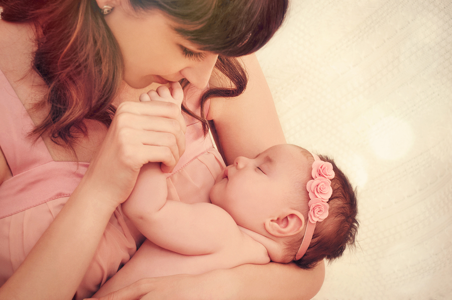 Caring Mother Kissing Little Fingers Of Her Cute Sleeping Baby G