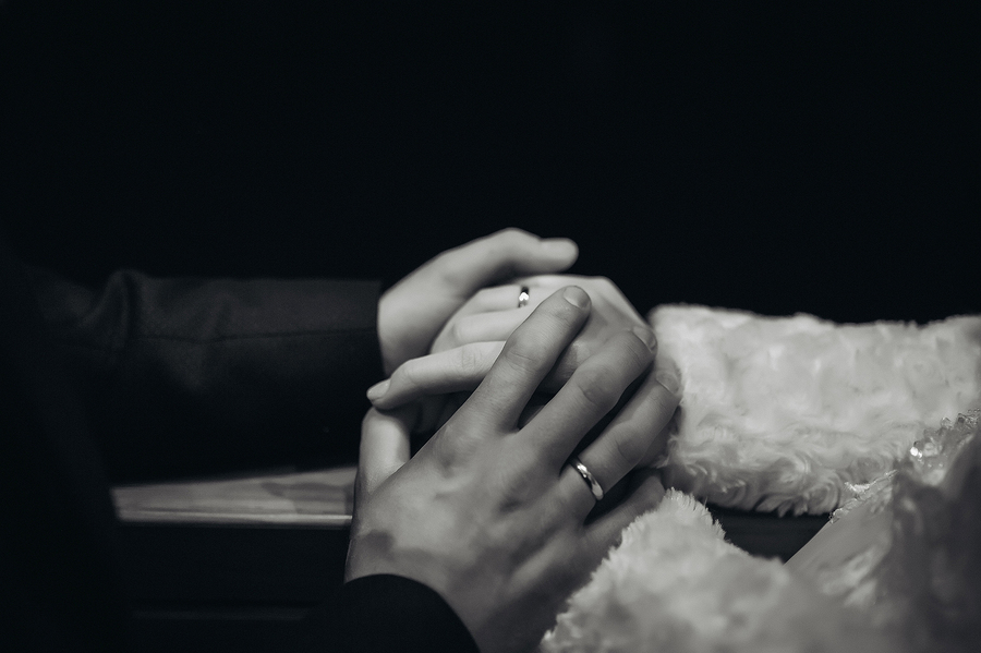Wedding composition the bride and groom holding hand in hand black and white image